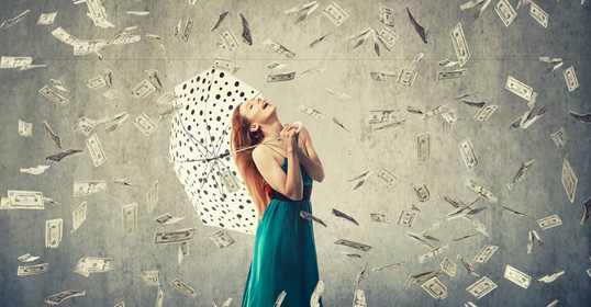 A woman dreamed of a lot of money falling from the sky.